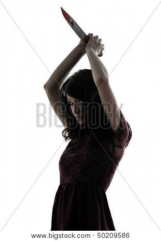 one caucasian strange young woman killer holding  bloody knife in silhouette white background