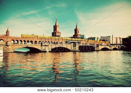 The Oberbaum Bridge, German Oberbaumbrucke and River Spree in Berlin, Germany. Retro, vintage version