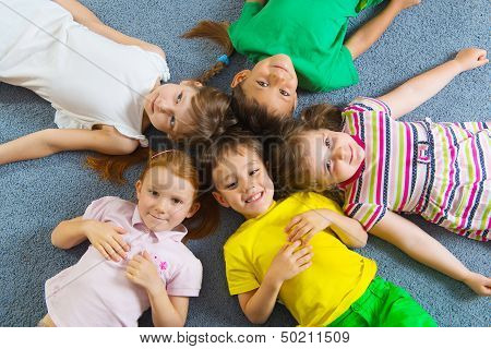 Cute Little Children Lying On Floor