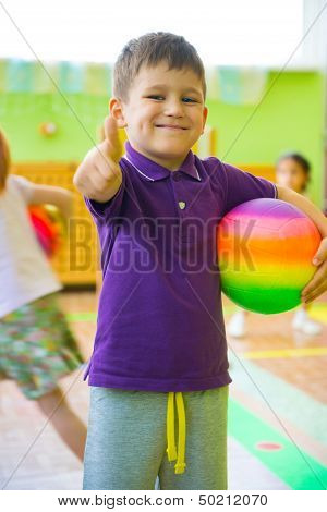 Cute Little Boy Playing At Daycare Gym
