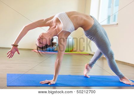 Beautiful Young Woman Yoga Workout