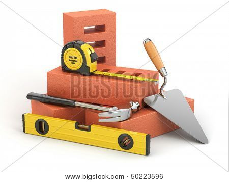 Construction concept. Bricks, trowel, hammer and level.