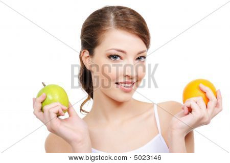 Beautiful Young Woman With Fruits