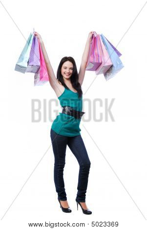 Beautiful Woman Holding Bags Over Head