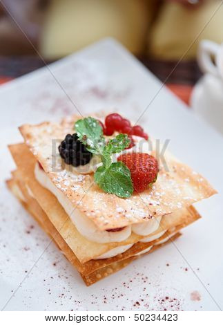 Mille-feuille cake with raspberries and sweet cream