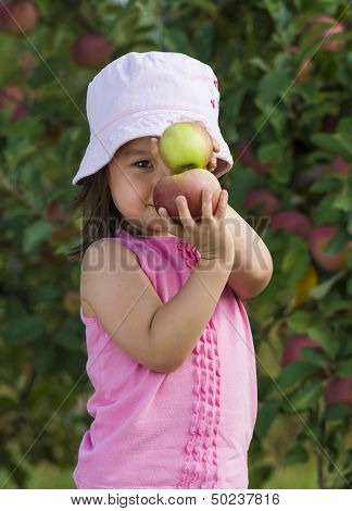 Girl Posing With Apples