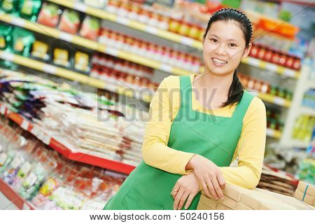 chinese young woman choosing food tea during shopping at china supermarket