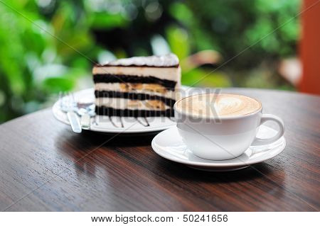 Cup of capuchino coffee with Chocolate Banana Cake