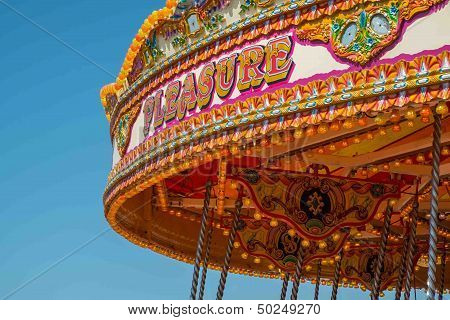 Close Up Of The Word Pleasure On A Vintage Merry Go Round