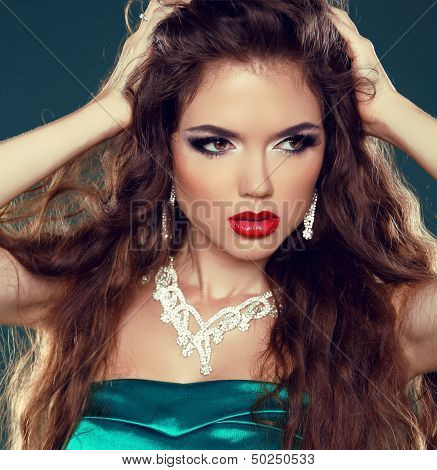 Makeup. Beautiful Brunette Woman With Red Lips. Sexy Girl With Jewelry.