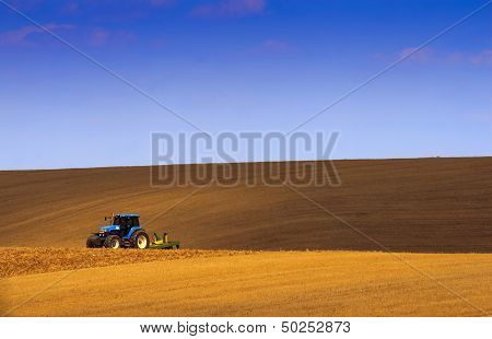 The Land Of The Tractor Under The Shade Of Sky Blue.