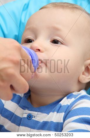 Little Boy Drinks Baby Milk