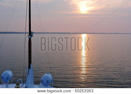 Summer sunset seen from the prow of a cruise liner