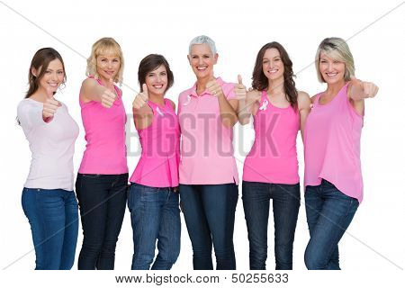 Positive women wearing pink for breast cancer posing on white background