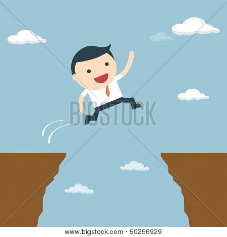 Businessman Jumping Over The Cliff To Goal