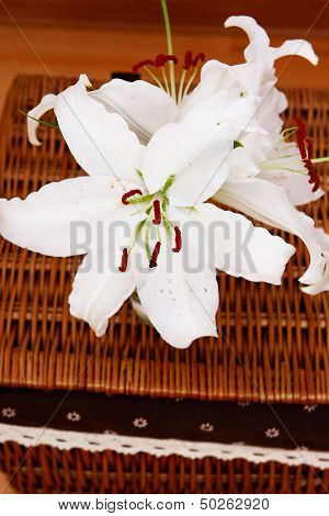 White Lilly Bouquet On Wicker Brown Basckets