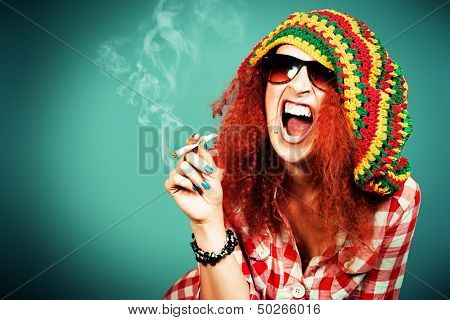 Portrait of a smiling rastafarian girl.