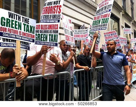 NEW YORK - SEPTEMBER 3: Taxi drivers protest outside the Taxi and Limousine Commission building in protest of new rules on September 3, 2013 in New York City.
