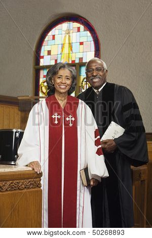 Female and male Reverends in church