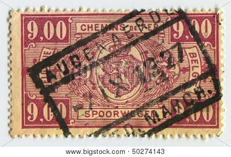 BELGIUM - CIRCA 1927: A stamp printed in Belgium shows image of the Coat Of Arms, circa 1927.
