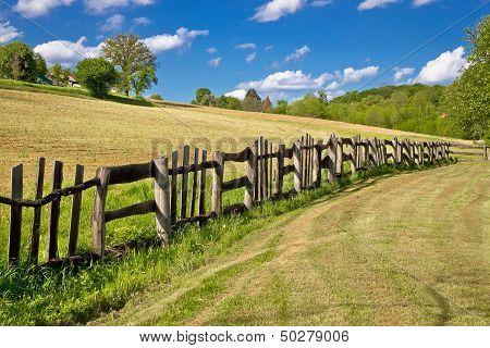 Wooden Fence In Green Landscape