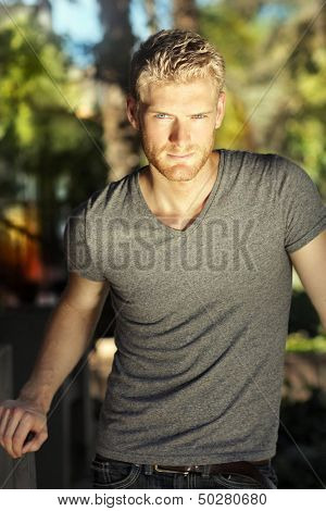 Sexy young male model with dramatic light and confident expression