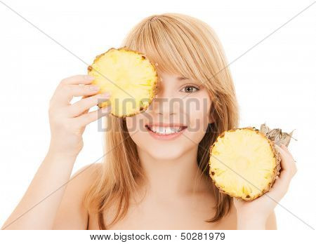 healty food and nutrition concept - happy girl with pineapple