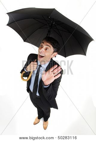 Man under an umbrella having an inspirational breakthrough looking up with his hand raised and a look of ecstatic wonderment on his face, comic high angle portrait isolated on white