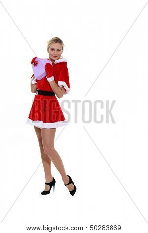 Attractive woman dressed as Mrs. Claus and holding a heart-shaped box