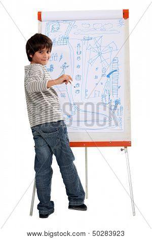 a little boy drawing on a whiteboard