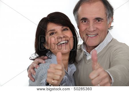 Couple giving the thumbs-up