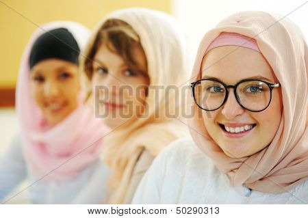Multi ethnic group of teenage students inside the high school classroom posing on board