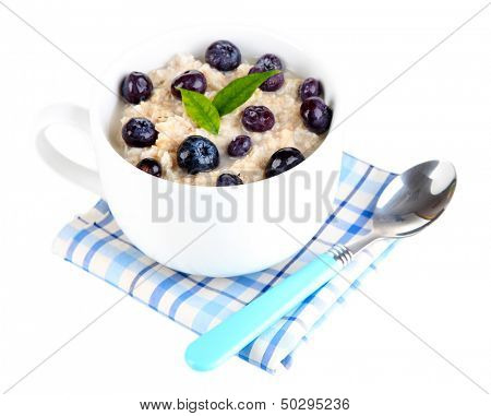 Oatmeal in cup with berries isolated on white