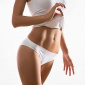 stock photo of stomach  - Beautiful slim body of woman in lingerie - JPG