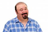 stock photo of cynicism  - Overweight man with a goatee beard and a skeptical expression looking at the camera with his eyebrows raised in distrust and a cynical smile isolated on white - JPG