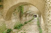 stock photo of dungeon  - Stone Corridor Road To An Ancient Castle Dungeon - JPG