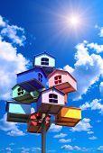 image of nesting box  - Colorful nesting boxes on blue sky - JPG