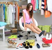 image of shoe-box  - Beautiful girl chooses shoes in room - JPG