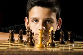 picture of 11 year old  - An 11 year old boy staring down his opponent during a game a chess - JPG