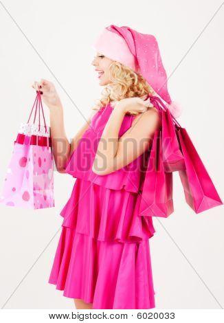 Fröhlich Santa Helfer Mädchen mit Einkaufstaschen