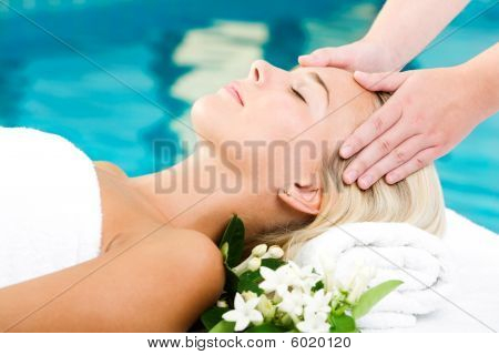 Beautiful young woman getting a spa treatment