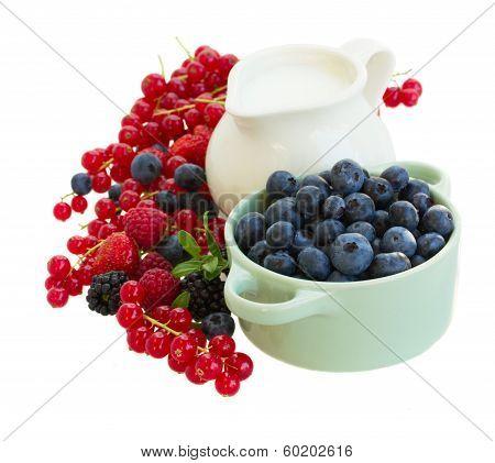 fresh berries with jug of  milk