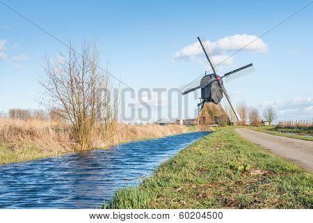 Dutch Windmill In A Polder Landscape