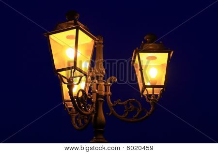 Three old lanterns at dusk