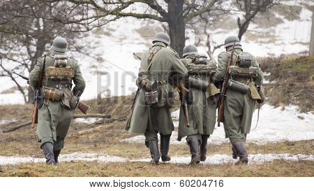 German Soldiers Retreating From The Battlefield