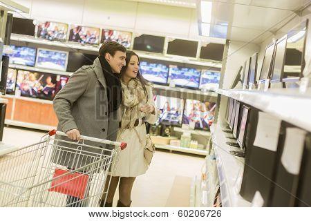 Young Couple Shopping Electronics