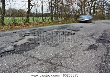 Car And Holes In The Asphalt