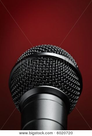 Microphone Against Red Background