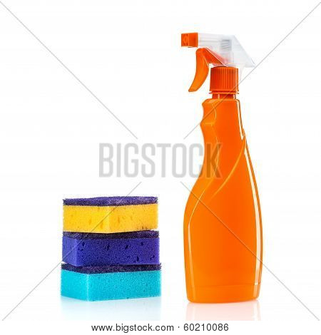 Plastic bottles of cleaning products and sponges . Isolated on white background