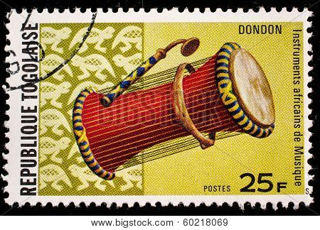 TOGO - CIRCA 1991: A stamp printed by Togo shows Dondon drum, circa 1991